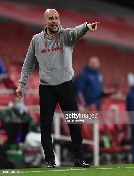 Pep Guardiola, Manager of Manchester City gives their team instructions during the Premier League match between Arsenal and Manchester City at...