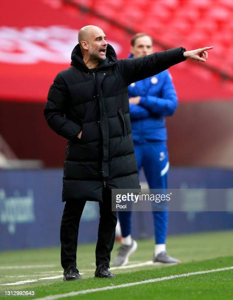 Pep Guardiola, Manager of Manchester City gives their team instructions during the Semi Final of the Emirates FA Cup match between Manchester City...