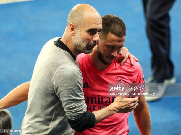 Pep Guardiola Manager of Manchester City greets Eden Hazard of Real Madrid following the UEFA Champions League round of 16 second leg match between...