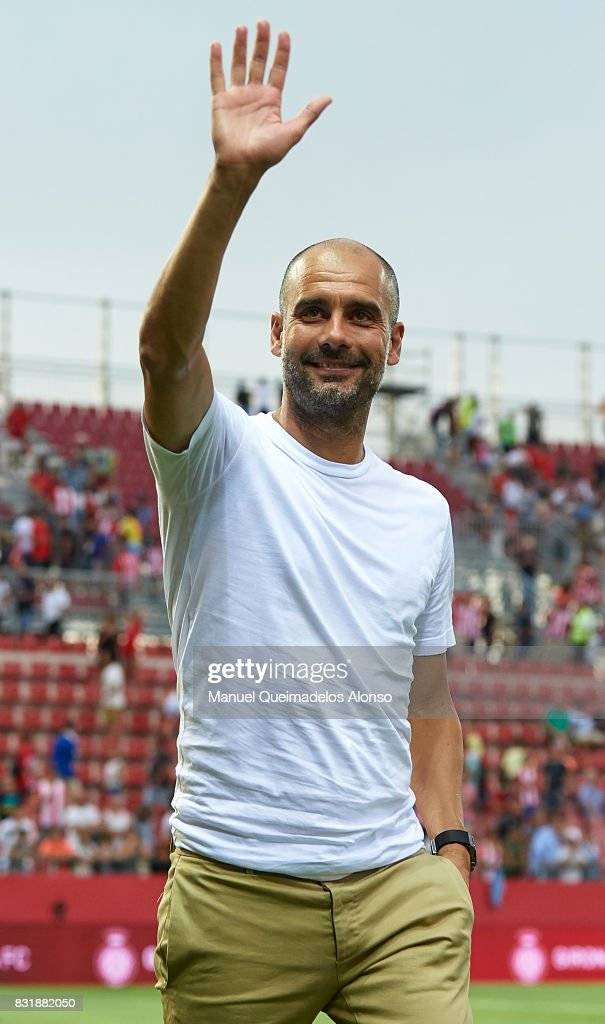 Pep Guardiola, Manager of Manchester City greets the fans after the end the pre-season friendly match between Girona and Manchester City at Municipal de Montilivi Stadium on August 15, 2017 in Girona, Spain.