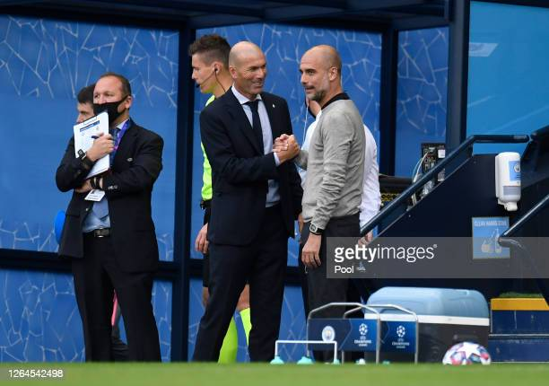 Pep Guardiola Manager of Manchester City greets Zinedine Zidane Head Coach of Real Madrid prior to during the UEFA Champions League round of 16...