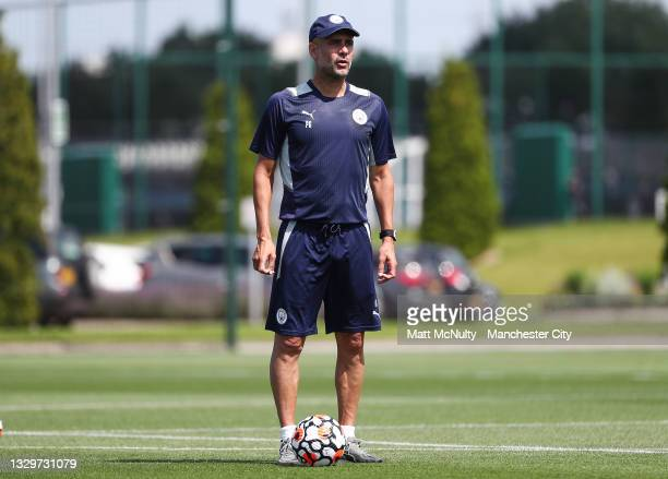 Pep Guardiola, manager of Manchester City in action during a training session at Manchester City Football Academy on July 20, 2021 in Manchester,...