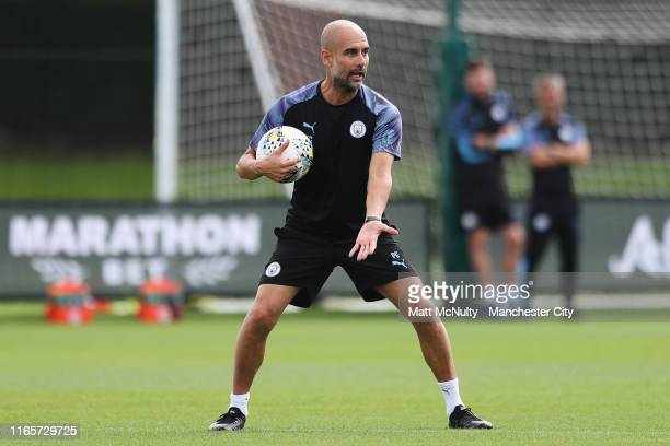 Pep Guardiola manager of Manchester City in action during the training session at Manchester City Football Academy on August 02 2019 in Manchester...