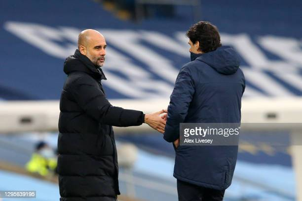 Pep Guardiola, Manager of Manchester City interacts with Aitor Karanka, manager of Birmingham City following the FA Cup Third Round match between...