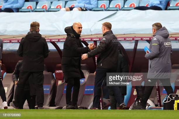 Pep Guardiola, Manager of Manchester City interacts with Dean Smith, Manager of Aston Villa prior to the Premier League match between Aston Villa and...