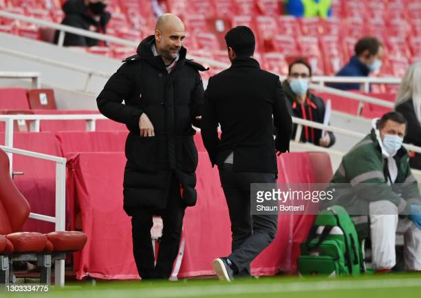 Pep Guardiola, Manager of Manchester City interacts with Mikel Arteta, Manager of Arsenal prior to the Premier League match between Arsenal and...