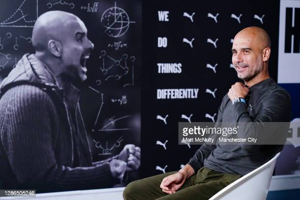 Pep Guardiola, manager of Manchester City is interviewed by City TV after signing a contract extension at Manchester City Football Academy on...