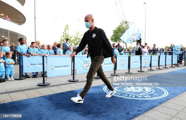 Pep Guardiola, Manager of Manchester City is seen wearing a face mask as he arrives at the stadium prior to the Carabao Cup Third Round match between...