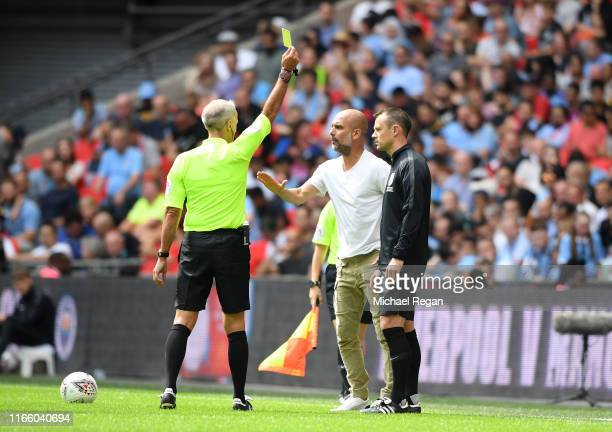Pep Guardiola, Manager of Manchester City is shown a yellow card during the FA Community Shield match between Liverpool and Manchester City at...