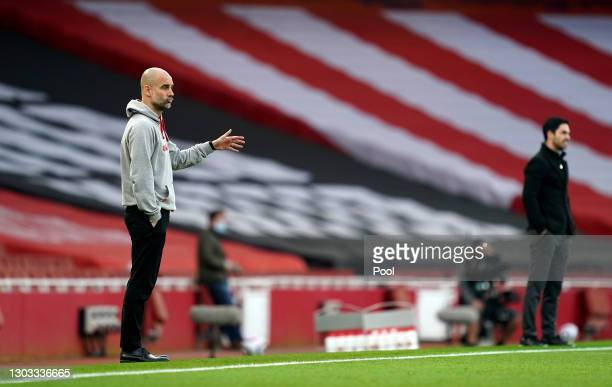Pep Guardiola, Manager of Manchester City issues instructions to his players during the Premier League match between Arsenal and Manchester City at...