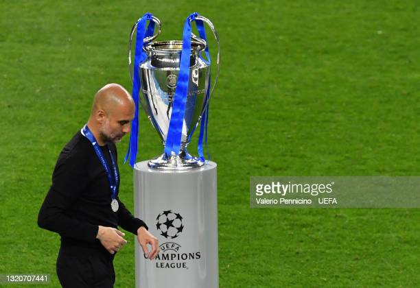 Pep Guardiola, Manager of Manchester City leaves the pitch with their runners up medal following the UEFA Champions League Final between Manchester...