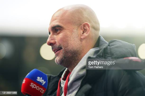 Pep Guardiola, Manager of Manchester City looks on ahead of the Premier League match between Aston Villa and Manchester City at Villa Park on April...