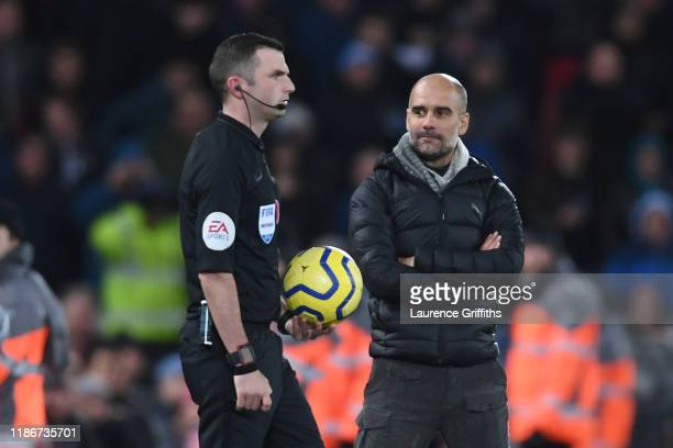 Pep Guardiola, Manager of Manchester City looks on at referee Michael Oliver as he walks onto the pitch for the second half during the Premier League...