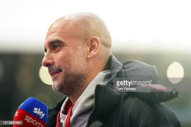 Pep Guardiola, Manager of Manchester City looks on during a Sky Sports interview prior to the Premier League match between Aston Villa and Manchester...