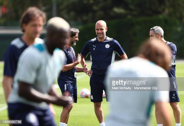 Pep Guardiola, manager of Manchester City looks on during a training session at Manchester City Football Academy on July 19, 2021 in Manchester,...