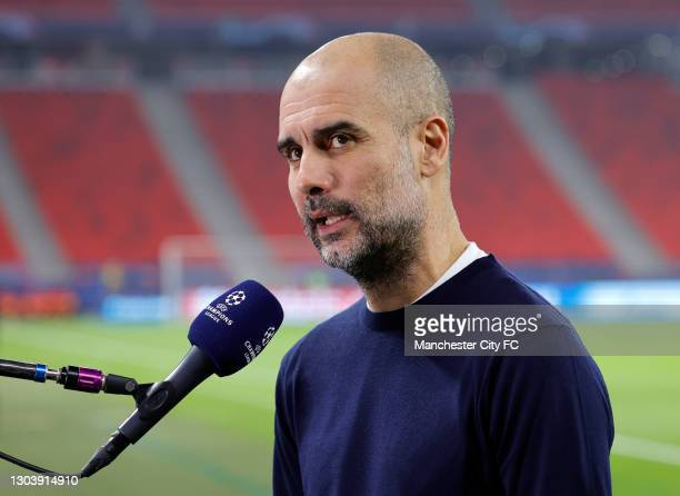 Pep Guardiola, Manager of Manchester City looks on during a TV Interview prior to the UEFA Champions League Round of 16 match between Borussia...