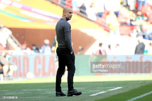 Pep Guardiola, Manager of Manchester City looks on during the Carabao Cup Final between Manchester City and Tottenham Hotspur at Wembley Stadium on...