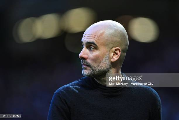Pep Guardiola Manager of Manchester City looks on during the Premier League match between Manchester United and Manchester City at Old Trafford on...