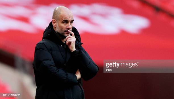 Pep Guardiola, Manager of Manchester City looks on during the Semi Final of the Emirates FA Cup match between Manchester City and Chelsea FC at...