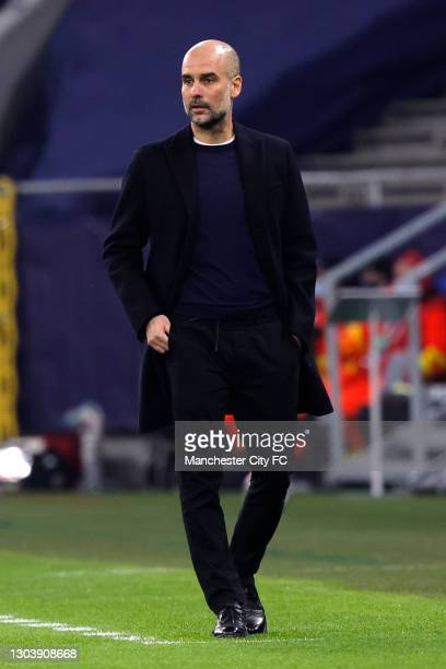 Pep Guardiola, Manager of Manchester City looks on during the UEFA Champions League Round of 16 match between Borussia Moenchengladbach and...