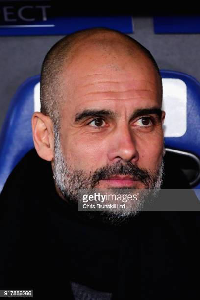 Pep Guardiola Manager of Manchester City looks on from the dugout during the UEFA Champions League Round of 16 First Leg match between FC Basel and...