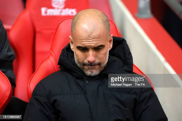 Pep Guardiola, Manager of Manchester City looks on prior to the Semi Final of the Emirates FA Cup match between Manchester City and Chelsea FC at...