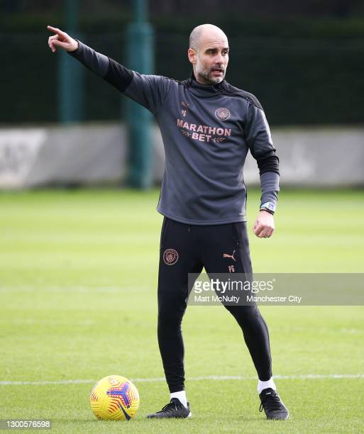Pep Guardiola, manager of Manchester City points during a training session at Manchester City Football Academy on February 05, 2021 in Manchester,...