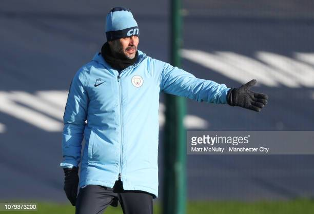 Pep Guardiola manager of Manchester City points during the training session at Manchester City Football Academy on January 8 2019 in Manchester...
