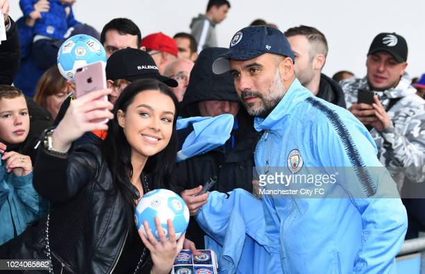 Pep Guardiola manager of Manchester City poses for a photograph during a open training session at Manchester City Football Academy on August 26 2018...