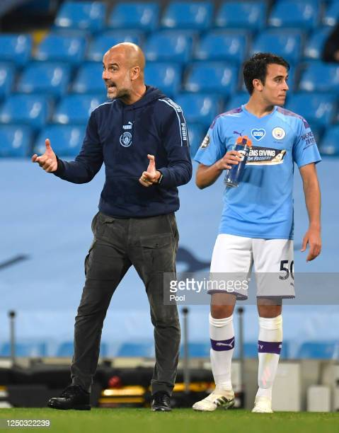 Pep Guardiola Manager of Manchester City reacts as Eric Garcia of Manchester City looks on during the Premier League match between Manchester City...