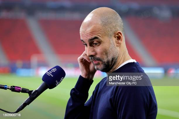 Pep Guardiola, Manager of Manchester City reacts during a TV Interview prior to the UEFA Champions League Round of 16 match between Borussia...