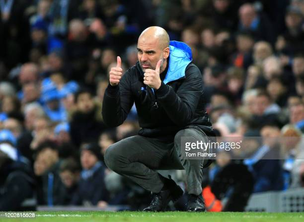 Pep Guardiola, Manager of Manchester City reacts during the Carabao Cup Semi Final match between Manchester City and Manchester United at Etihad...