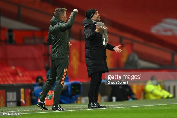 Pep Guardiola, Manager of Manchester City reacts during the Carabao Cup Semi Final match between Manchester United and Manchester City at Old...