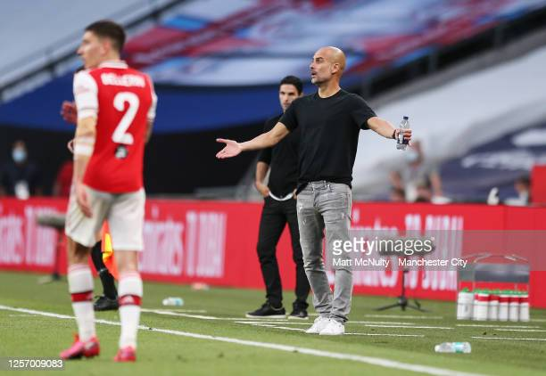 Pep Guardiola manager of Manchester City reacts during the FA Cup Semi Final match between Arsenal and Manchester City at Wembley Stadium on July 18...