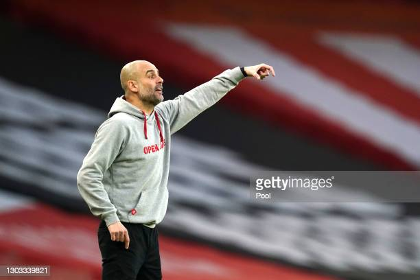 Pep Guardiola, Manager of Manchester City reacts during the Premier League match between Arsenal and Manchester City at Emirates Stadium on February...