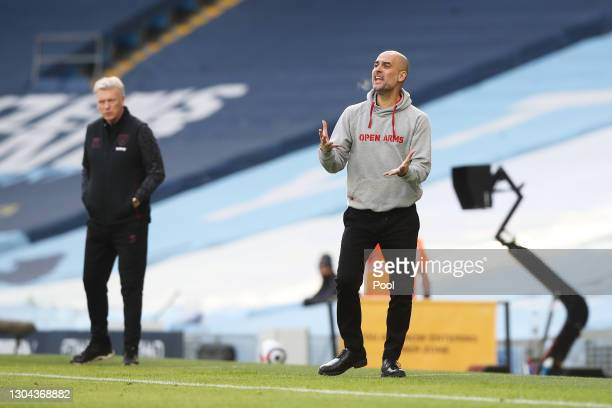 Pep Guardiola, Manager of Manchester City reacts during the Premier League match between Manchester City and West Ham United at Etihad Stadium on...