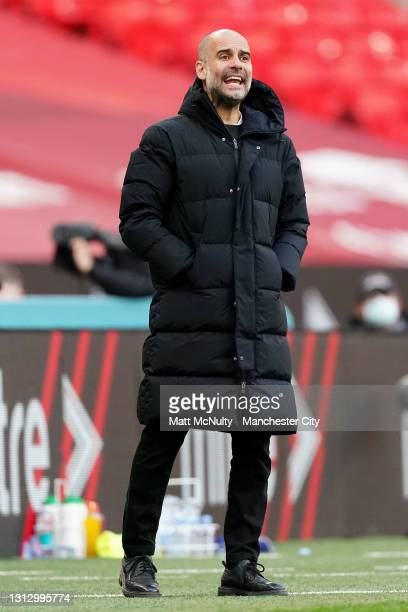 Pep Guardiola, Manager of Manchester City reacts during the Semi Final of the Emirates FA Cup match between Manchester City and Chelsea FC at Wembley...