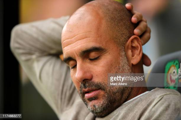 Pep Guardiola Manager of Manchester City reacts prior to the Premier League match between Norwich City and Manchester City at Carrow Road on...