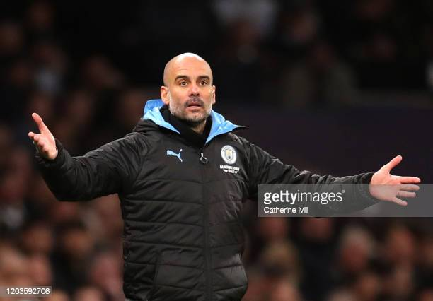 Pep Guardiola Manager of Manchester City reatcs during the Premier League match between Tottenham Hotspur and Manchester City at Tottenham Hotspur...