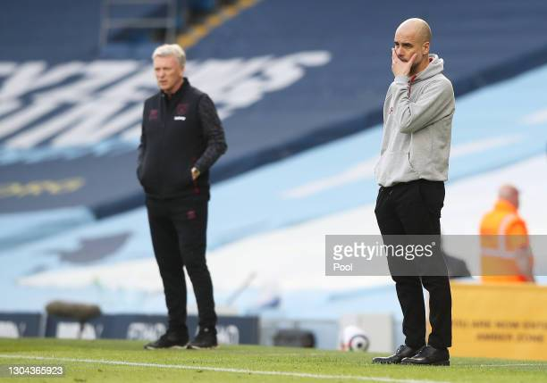 Pep Guardiola, Manager of Manchester City recats during the Premier League match between Manchester City and West Ham United at Etihad Stadium on...