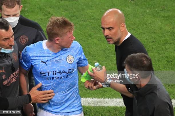 Pep Guardiola manager of Manchester City removes Kevin De Bruyne captain armband as he is forced off through injury during the UEFA Champions League...