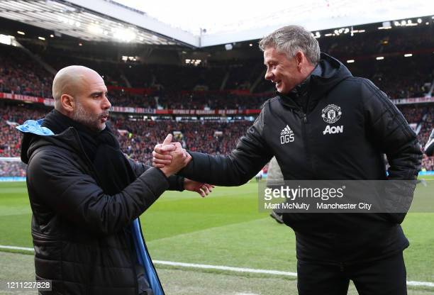 Pep Guardiola Manager of Manchester City shakes hands with Ole Gunnar Solskjaer Manager of Manchester United during the Premier League match between...