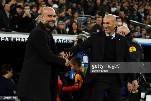 Pep Guardiola Manager of Manchester City shakes hands with Zinedine Zidane Manager of Real Madrid prior to the UEFA Champions League round of 16...