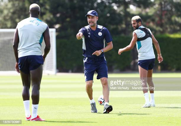 Pep Guardiola, manager of Manchester City shouts instructions during a training session at Manchester City Football Academy on July 20, 2021 in...