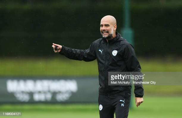 Pep Guardiola manager of Manchester City shouts instructions during the training session at Manchester City Football Academy on August 14 2019 in...