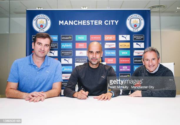 Pep Guardiola, manager of Manchester City signs a contract extension along side Chief Executive Ferran Soriano and Director of Football Txiki...