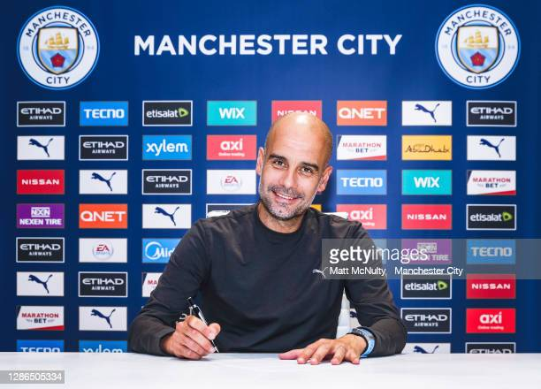 Pep Guardiola, manager of Manchester City signs a contract extension at Manchester City Football Academy on November 19, 2020 in Manchester, England.