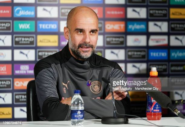 Pep Guardiola, manager of Manchester City speaks during a press conference at Manchester City Football Academy on December 11, 2020 in Manchester,...