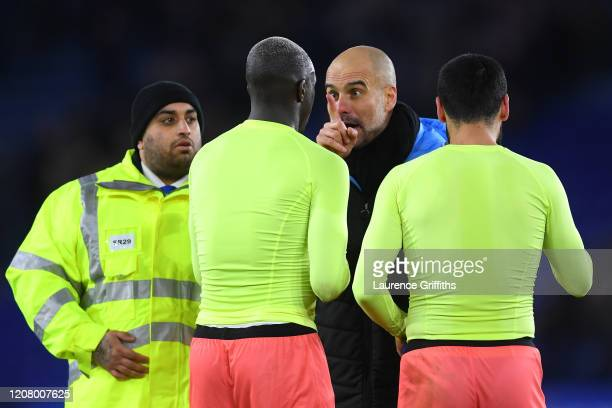 Pep Guardiola, Manager of Manchester City speaks to Benjamin Mendy of Manchester City during the Premier League match between Leicester City and...