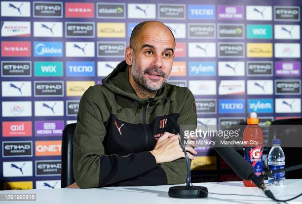 Pep Guardiola, manager of Manchester City speaks to the media during a press conference at Manchester City Football Academy on December 18, 2020 in...